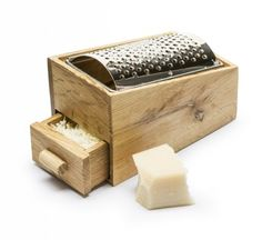 This oak and stainless steel cheese grater makes an amazing gift for cheese lovers! The cheese you grate ends up in the drawer underneath the grater, Spiral Cutter, Vegetable Slicer, Cheese Grater, Cheese Lover, Grated Cheese, Kitchen Accessories, Kitchen Gadgets, Parmesan, Best Gifts