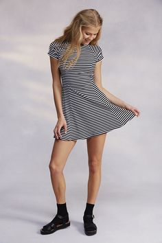 A little black and white stripped dress.....makes a really trendy outfit with added accessories