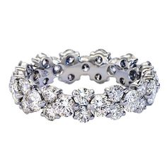 Platinum eternity ring with alternate-sized diamonds by Blue Nile
