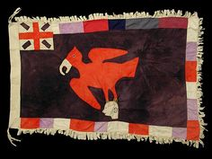 Fante Asafo Flag 44 - Despite its appearance this flag shows no real evidence of age or use and could have been made to be sold. Newer flags made to be sold usually use an image of the British Union Jack rather than the post 1957 Ghanaian flag. The reverse side can be appliqued with the same image, or the image can show through on the reverse side through a cut-out in the flag rather than as an appliqued design.  On this flag the same image shows on the reverse side through a cut-out in the…
