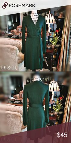 """🌷🆕Anna Franco Dark Green Wrap Dress🌷 Re-Posh-I purchased this beautiful dark green Anna Franco Wrap Dress for my Mom as well, and it was also a bit too big. This dress was lovingly worn by the previous Posher and she stated she received a ton of compliments! The dress is super soft and has the classic, vintage feel of a wrap dress. There are no flaws, length is approximately 38"""" long, 94% spun rayon, and 6% elastane. Size 4. Anthropologie Dresses Long Sleeve"""