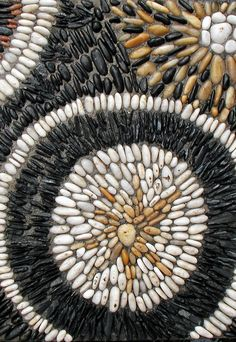 pebble mosaic, Hmm, looks like beans to me!  I'm going to try to make a design like this for the wall.