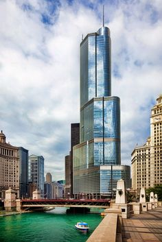 Trump Tower and River Walkway on the Chicago River,  Chicago, Illinois by…