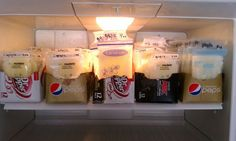 Storing Frozen Breastmilk: I just cut the tops off the pop fridge packs and fill them with my frozen breastmilk bags (I freeze them laying down first so they are flat).
