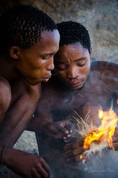 Building a fire, old fashion way - Bushman of Namibia, Africa