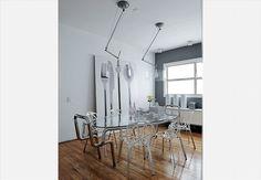 A sala de jantar colorida tem quadro do fotógrafo Valentino Fialdini, cadeira Mademoiselle, mesa Saarinen e até a imagem de uma santa. Casa do paisagista Gil Fialho e de sua esposa