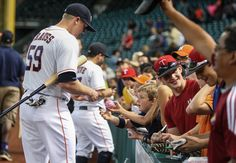 CrowdCam Hot Shot: Houston Astros designated hitter Marc Krauss signs autographs for fans before a game against the Cincinnati Reds at Minute Maid Park. Photo by Troy Taormina
