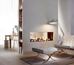Transparent Dual Aspect Fireplace As Room Devider With Modern White Floor Lamp And Couch
