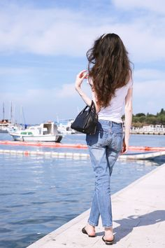 Fashion blogger Veronika Lipar of Brunette From Wall Street sharing 5 accessories that elevate any casual outfit while by the Adriatic sea
