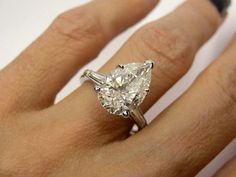 Estate Vintage 5.01ct Classic Pear Cut Engagement Ring in Platinum with Baguettes, Circa 1960