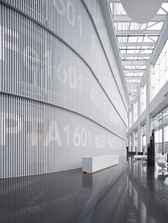writing on shutters to create a a code which feels like a discovery. Huge white blinds in a lobby | (re)Pinned by www.INinterieurs.nl