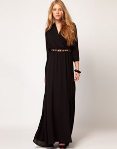 Mango Maxi Dress With Thigh Split  SGD$216.73  This maxi dress by Mango has been crafted from a fluid, flowing fabric. The details include: a wrap front with a V-neckline, a cinched waistband, a layered maxi length skirt with a split to the thigh, and cropped blouson sleeves. The dress has been cut with a relaxed flowing fit.