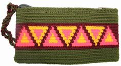 Why fit in when you were born to stand out! One of our beautifully colored, handmade bags can help you do just that. Single thread Putchipuu clutch bag, hand crocheted by the women of the Wayuu people