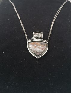 Camera positioned too low The angle makes it hard to really see the jewelry Jewelry Photography, Pendant Necklace, Diamond, Phone, Telephone, Diamonds, Mobile Phones, Drop Necklace