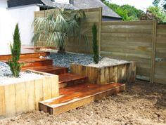 Création d'une terrasse en bois et d'un aménagement paysager avec végétaux exotiques. Arbor minéral paysagiste Vannes, auray, carnac, arradon, baden, séné, sarzeau, elven, 56, morbihan
