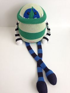 These designs are not permitted to be copied or sold by anyone other than www.birdistheworddesign.etsy.com. Smug Monsters are original, one of a kind plush designs that are made with consideration for the environment using upcycled materials.