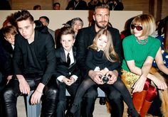 Harper Beckham was just as grumpy as North West, sitting in the front row at her mother Victoria Beckham's Mercedes-Benz New York Fashion Week show on Sunday, Feb. 15; see the photos