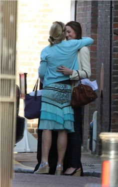 Kate Middleton arrives at Clarence House two days before her wedding, April 27, 2011. She is seen hugging a staff member of Clarence House. Kate met Prince William at Clarence House, where the couple were said to have met the Dean of Westminster Abbey for a run-through of the wedding service.