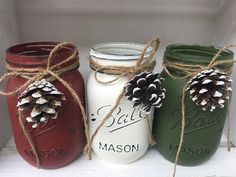 These Festive jars will be a great addition to anyones holiday decor. The listing is for 3 pint size Ball Mason Jars in brick red, vintage white and olive green. Each jar has twine tied at the neck and a real pine cone for that holiday rustic look. They would also look great holding candy canes, cinnamon sticks or holiday candy. These jars are hand painted, distressed, and sealed with two coats of a soft touch matte varnish. They are painted on the outside allowing them to hold water. The…