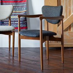Scale wise. Would tie in to the coffee table. Would get the light color and then can reupholster if we want, or get a small round pillow with a pattern for the back. Dane Arm Dining Chair   west elm
