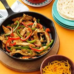 Chicken Fajitas. The marinated chicken in these popular wraps is mouthwatering. They go together in a snap and always get raves!