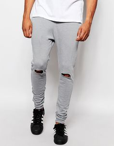 "Joggers by ASOS Loop-back sweat Drawstring waistband Side pockets Single back pocket Ripped knees Fitted cuffs Super skinny - cut closest to the body Machine wash 63% Cotton, 37% Polyester Our model wears a 32""/81 cm regular and is 185.5cm/6'1"" tall"