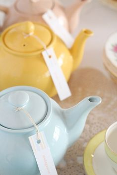 hello naomi blog...cute tea party baby shower idea. I love the many mini tea pots in different colours!