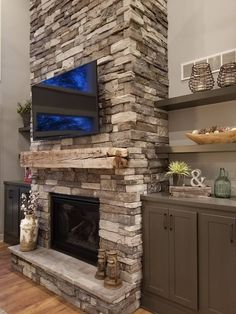 Muston Construction Inc. is a custom home builder serving the Grand Rapids Michigan area. Basement Fireplace, Fireplace Built Ins, Farmhouse Fireplace, Home Fireplace, Fireplace Remodel, Living Room With Fireplace, Fireplace Makeovers, Fireplace Ideas, Stone Fireplace Designs