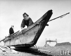 Ainu chief preparing boat for fishing. His fish spear is bone tipped, Shiraoi, 1946 by Alfred Eisenstaedt