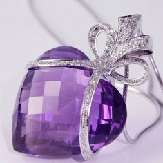 Heart-shaped Amethyst and Diamond Bow Pendant