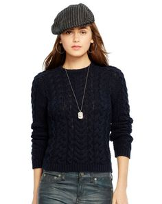 This crewneck sweater is cable-knit from rich cotton and features a slim-fitting silhouette. Crew neckline. Long sleeves with ribbed cuffs. Ribbed hem. 100% cotton. Hand wash. Imported.