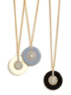 Go Gatsby with this to-die-for deco-inspired enamel pendant, swinging delicately from a golden chain and covered in a healthy amount of crystals.