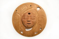 """When The Eclipse Broke Through by Rande Cook (Kwakwaka'wakw), hand carved red cedar. 39"""" x 39"""". """"It's a spirit whale and like the eclipse only shows himself so very little. But with the force of the moon pulling in the tides the spirit whale appears bringing fortune to all. The piercing in the moon are the shadows of the eclipse breaking through, after the moon is once illuminated again guiding the fortunate into prosperity life will balance out and the new era will be at one with the past""""."""