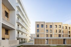 Image 4 of 29 from gallery of 71 Social Housing Units La Courneuve / JTB. Photograph by Luc Boegly Architecture Photo, Contemporary Architecture, Timber Staircase, Building Layout, Student House, Timber Cladding, Design Fields, Social Housing, Duplex House
