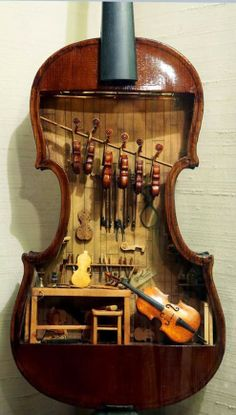 Tiny violin shop inside of a human-sized #violin!  And all the little ones are playable!