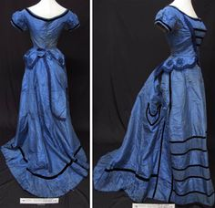 Two-piece ballgown ca. 1870s. Royal blue silk with trims of black velvet ribbon and blue corded motifs. Bustle skirt. Bodice lined in white polished cotton; skirt in cotton with bottom half treated with a waterproof substance. Bow at back of waist is separate. The Kauri Museum, ­Matakohe, via New Zealand Museums