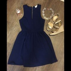 NWOT Navy Fit and Flare Dress Sz S NWOT navy Everly dress purchased from Lulu*s. Sleeveless and v-neck slit with gold zipper up the back.  Perfect for a summer wedding with patterns heels and a statement clutch!  Everly Dresses