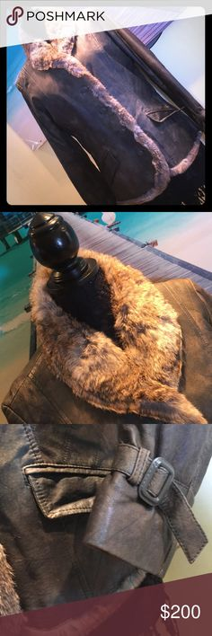 Leather and real rabbit fur coat w/ Gift fur Hat Canadian design and a layer of insulation make this coat extra versatile. I've outgrow this or I'd be keeping it. Two pockets on front. Many nice features and details. Back adjusts for better fit.  Excellent condition with no flaws or smells. COMES with fur hat of choice as a gift for limited time if purchased at list price. Approximately 20 inches pit to pit when buttoned. (Dan121317) Danier Jackets & Coats