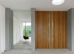 Contemporary Interior Design With Concrete Wall And Hand Finished Cherry Wood Details Also Washed Floor Screed Ideas: Contemporary Lake House in Germany by LHVH Architekten