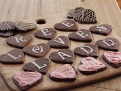 Chocolate Message Cookies : You don't need to wait for a special occasion to surprise friends and family with these sweet heart-shaped cookies. Once they're cooled, decorate the cookies with pink buttercream, melted chocolate and stenciled letters. Then arrange them on a serving tray to spell out a personalized message.