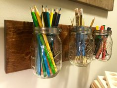 Wall mounted mason jar storage organizer perfect for your workspace or kitchen for functional storage. This decor features a wooden base with three attached mason jars. Use the mason jars to store anything from wooden spoons to paint brushes. Measures 18L x 5.5H Thank you for visiting our shop