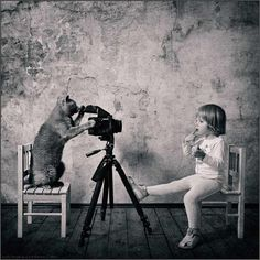 Photos Capture the Friendship Between a Little Girl and Her Cat