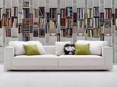 Photo de canapé blanc 3 places dans salon chic avec bibliothèque murale → touslescanapes.com