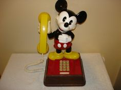 "Mickey Mouse Talking Phone - Scroll through the ""phone book"", dial the 3 digit ""telephone number"" and hear their voice."