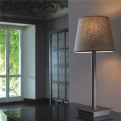 Promemoria, made in Italy: Cecile table lamp, project by Romeo Sozzi. Table lamp with touch switch. Hammered bronze structure. Round or square linen/cotton or silk lampshade with handsawn edge, methacrylate diffusers. Available with square lampshade with decorative details in smooth moro. #piso18casa #masaryk #promemoria #luxury #luxurylifestyle #qualitybrand #beautifullifestyle #madeinitaly #italiandesign #contemporarydesign #contemporaryinteriors #contemporary #modern #modernfurniture…