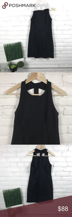 "Kate Spade Billie Bow T Back Dress KATE SPADE NEW YORK ""BILLIE BOW"" T BACK DRESS  Size: 6 Armpit to armpit: 16.25"" Armpit to hem: 25.25"" -Halter neck line with back bow and button placket detail. -Darted bodice; seamed waist. -Pleated straight skirt. -In excellent condition and so adorable!! kate spade Dresses"