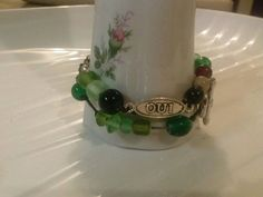 Check out this item in my Etsy shop https://www.etsy.com/listing/207789831/french-charm-oui-wrap-bracelet-glass