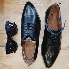 Menswear inspired and hopelessly cool- our new Erica oxfords from Frye and a classic pair of Toms shades.