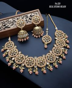 Order Fancy Necklace Designs via Whatsapp on Our fashion magazine personal shoppers helps you get the stylish look for you. Indian Jewelry Earrings, Indian Jewelry Sets, Indian Wedding Jewelry, Jewelry Design Earrings, Bridal Jewelry Vintage, Bridal Jewelry Sets, Girls Jewelry, Bridal Jewellery, Antique Jewellery Designs