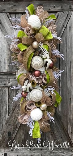 I like these colors for winter wreath door swag. Natural item and colors with enough bright green to remind me that spring is coming. Christmas Door Hangings, Christmas Swags, Burlap Christmas, Holiday Wreaths, Christmas Time, Christmas Crafts, Christmas Ornaments, Holiday Decor, Winter Wreaths
